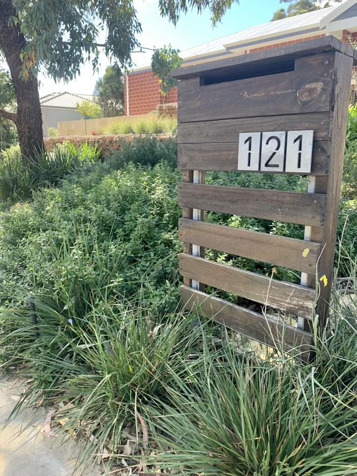 Pallet letterbox in a matured garden